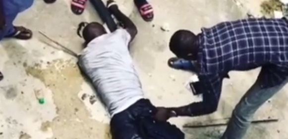 Thief jumps into Lagos lagoon after snatching phone from a passenger in traffic