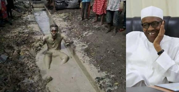 Another man soaks himself inside gutter to celebrate President Buhari's re-election (Photo)
