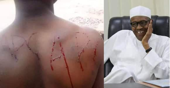Man bleeds after tattooing  APC into his skin to celebrate President Buhari's re-election