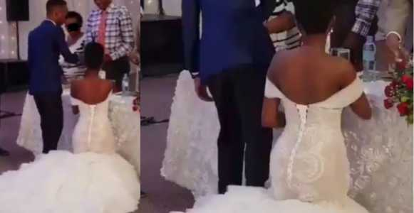 Photo of Nigerian bride kneeling to greet guests at her wedding sparks an outrage on social media