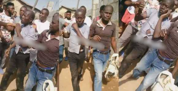 Two men disgraced publicly after being caught picking human hair in Abuja (Video)
