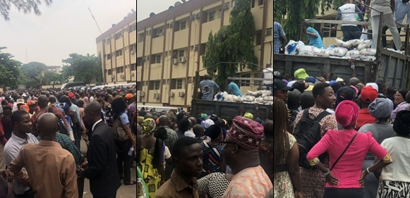 Lagos State Civil Servants Struggle for Bags of Rice Reportedly Given to Them by APC's Sanwo-Olu Ahead Of Elections