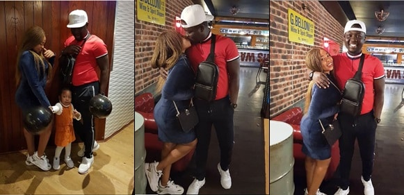 Comedian Seyilaw shares a kiss with his wife Stacey during a 'great night out' with his family in London