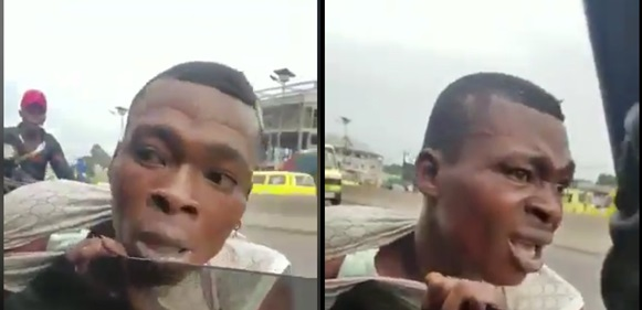 Traffic thief slapped ruthlessly after he's caught trying to steal phone in moving car