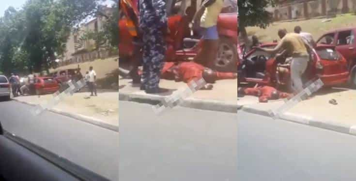 Driver slumps while being manhandled by a police and tax force officers (Video)