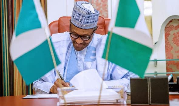 Buhari signs N30,000 minimum wage bill