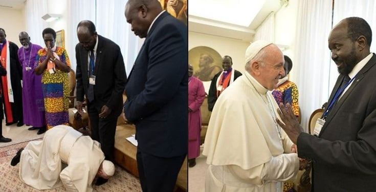 Pope Francis kneels and  kisses the feet of Sudanese leaders