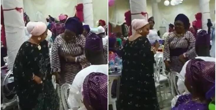 Lizzy Anjorin and Tobi Bakre's mother giving them Zanku at Femi's wedding