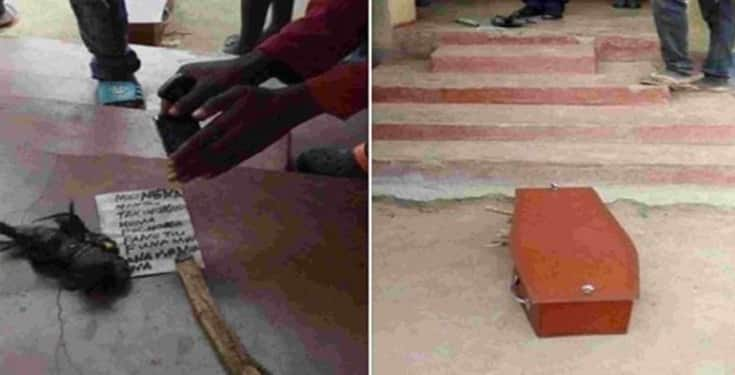 Man wakes up to find coffin and charm in front of his house