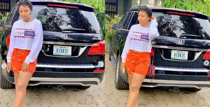 "Regina Daniels shows off her customized ""4 Eva 16"" plate Number on her Mercedes Benz SUV"