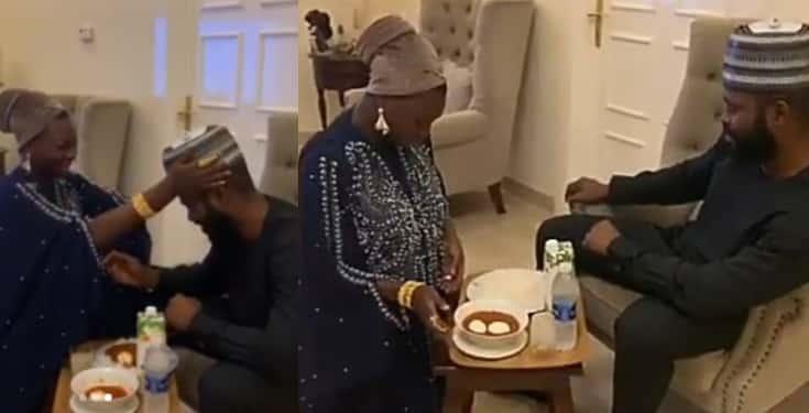 Relationship therapist, Jaruma kneels to serve her husband food (Video)