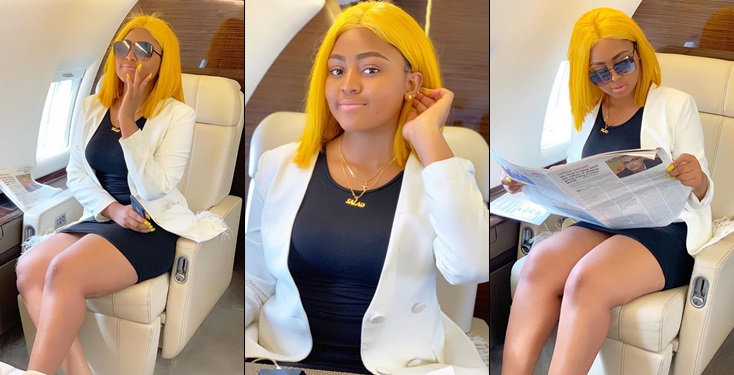 Regina Daniels poses inside hubby's private jet