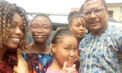 Tony Umez poses with his four daughters