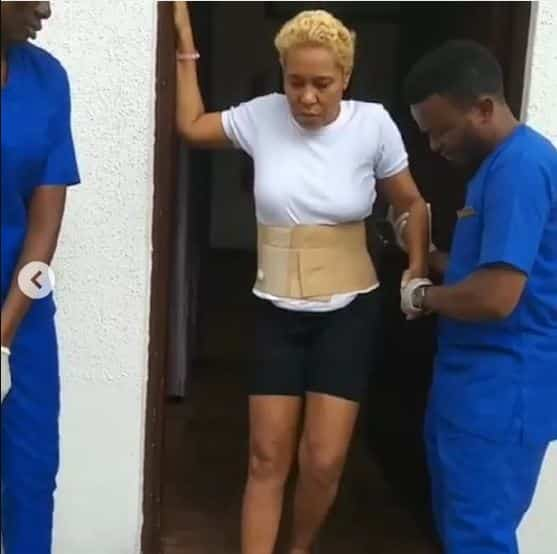 Shan George steps out for the first time after spine surgery (photos)