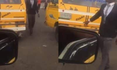 Bus conductor spotted in suit and tie in Lagos (video)