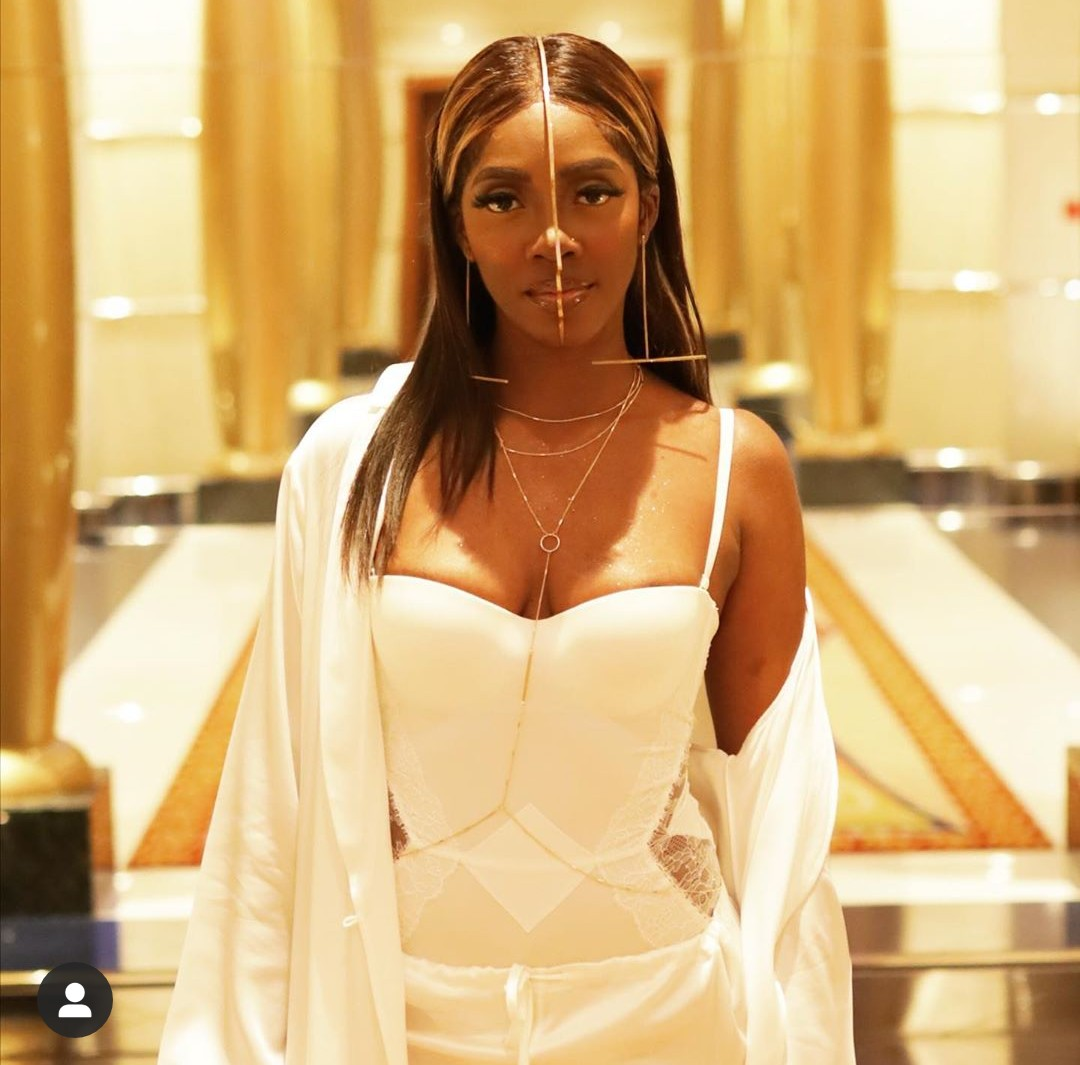 Tiwa Savage in shock as an excited fan pulls her down on stage (Video)