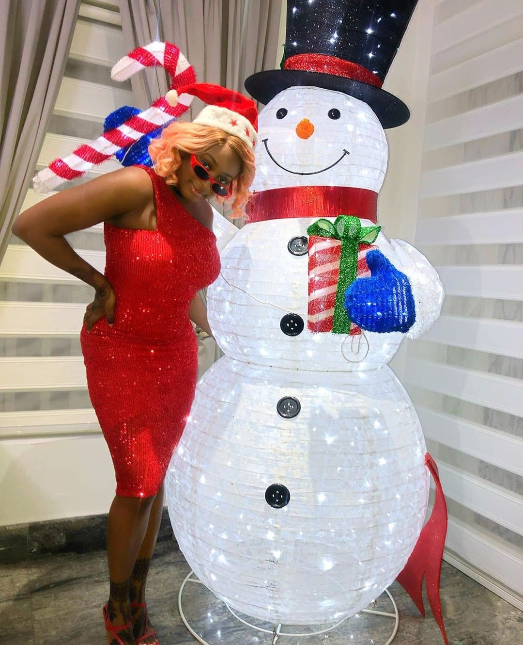 DJ Cuppy stacks N500k in a fridge to gift her manager, Elizabeth (Video)