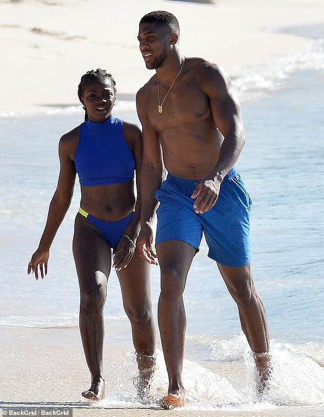 Anthony Joshua caught with a female companion at Barbados beach (Photos)