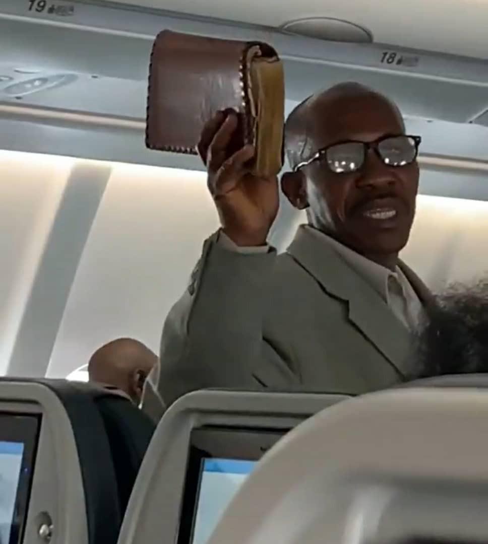 Trending video of an African man preaching the gospel onboard a flight_1