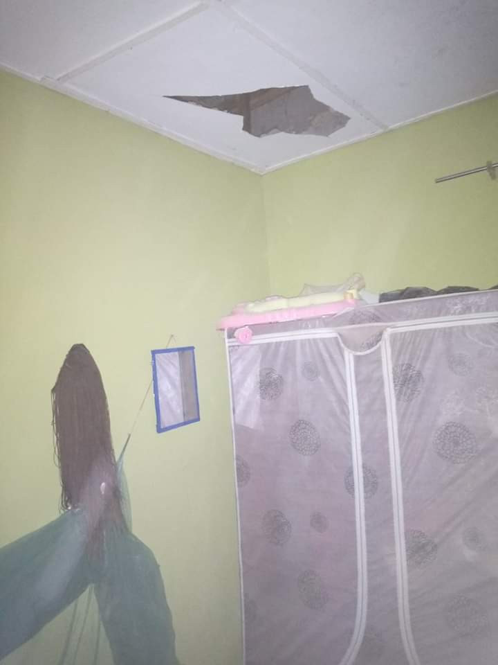 Nigerian woman and her baby almost killed as huge block crashes through roof, bedroom ceiling, and fell on them while sleeping (photos)_2