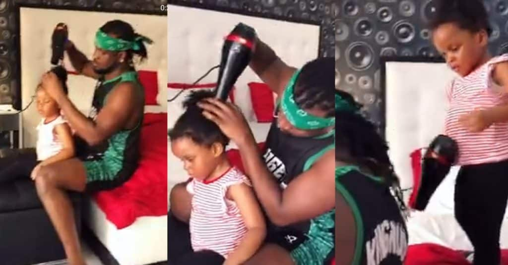 Rudeboy makes his daughter's hair