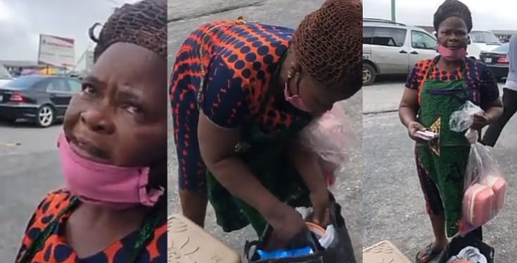 Food seller breaks down in tears, begs good samaritan to eat after he surprised her with cash gift on the road (Video)