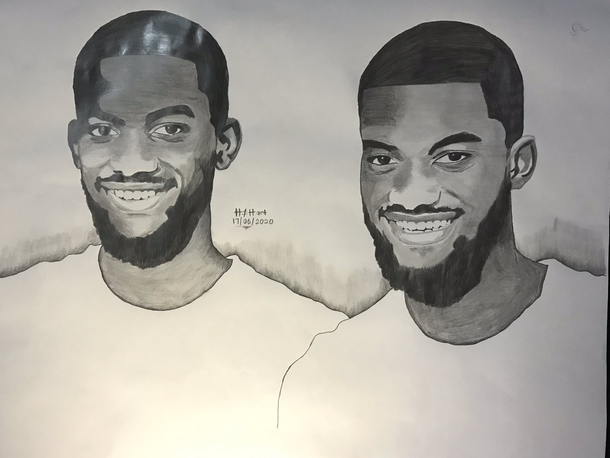 Talented twins draw themselves