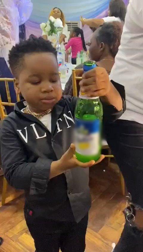 Boy consumes beer at a party
