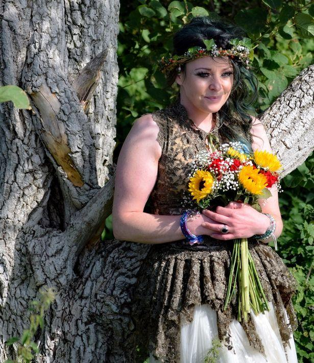 Woman celebrates first wedding anniversary with tree