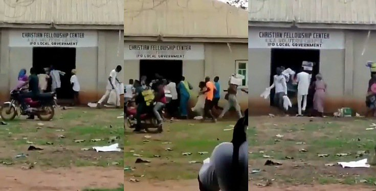 Hoodlums cart away food items in a church