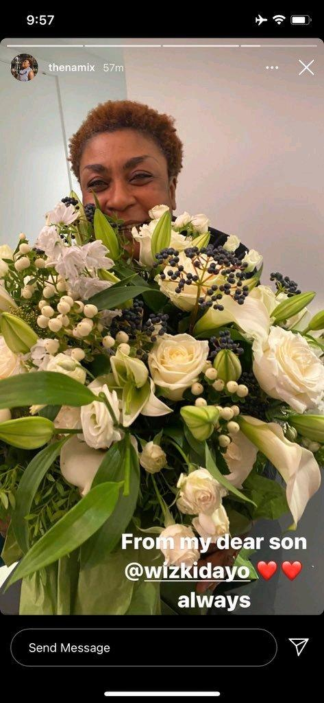burna boy's mother, bose ogudu receives flowers from wizkid