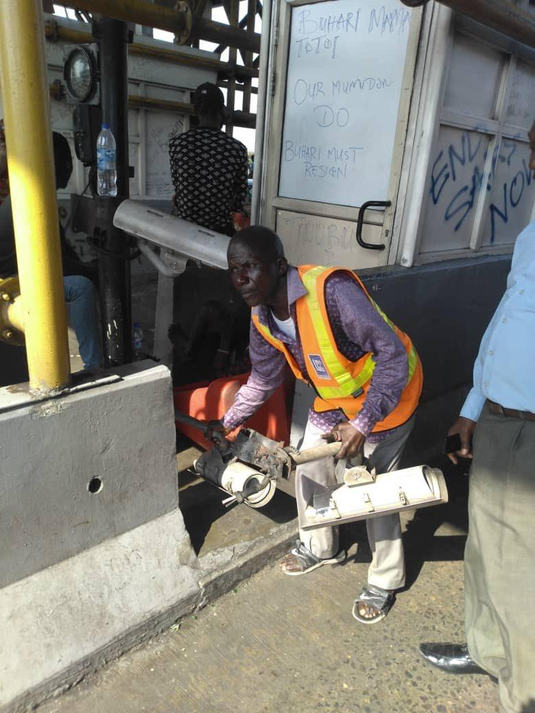 LCC worker removing cctv camera from lekki tollgate