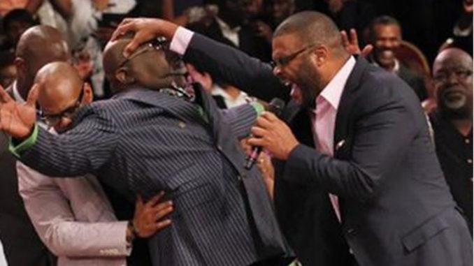 pastor performing miracle with speaking in tongues
