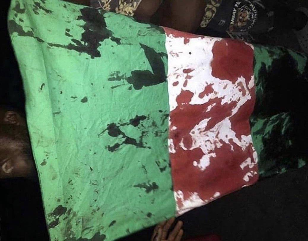 flag-stained-in-blood-lekki shooting