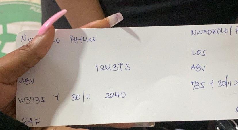 handwritten boarding pass