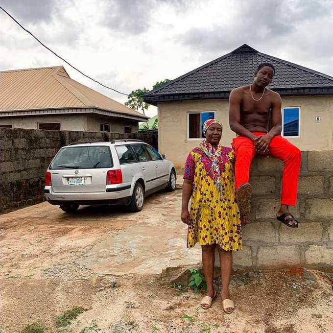 Young man celebrates after building a house for his mother