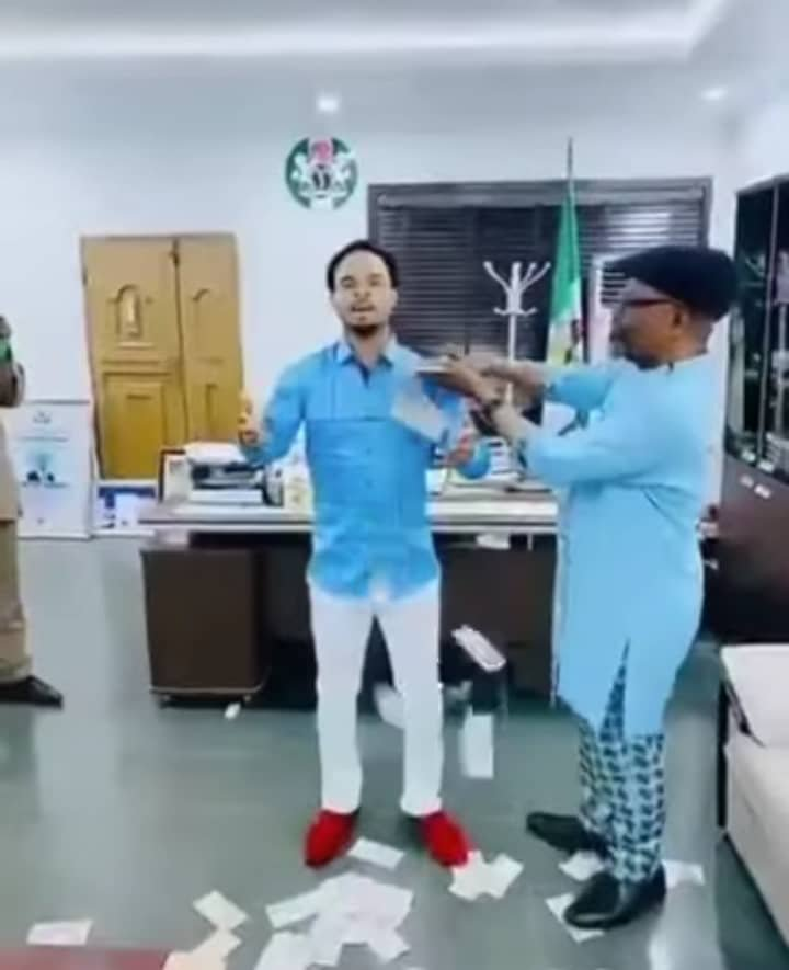 Spraying money on Odumeje in the office
