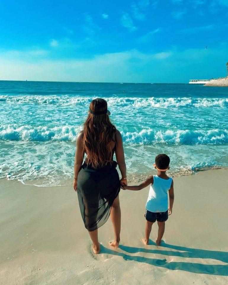 Davido reacts as Tiwa Savage shares beach photos with son on vacation