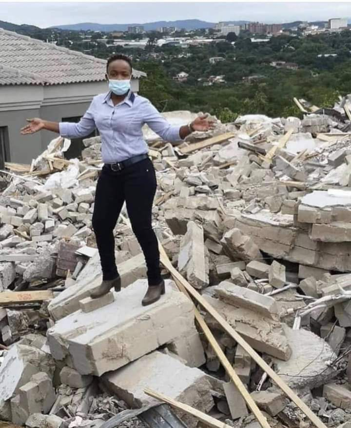 Lady poses on demolished house