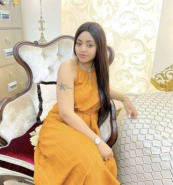 Lady inks tattoo of actress, Regina Daniels on her body