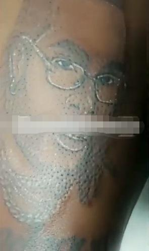 Lady tattoos Burna Boy's face and name of her lap and chest (Video)