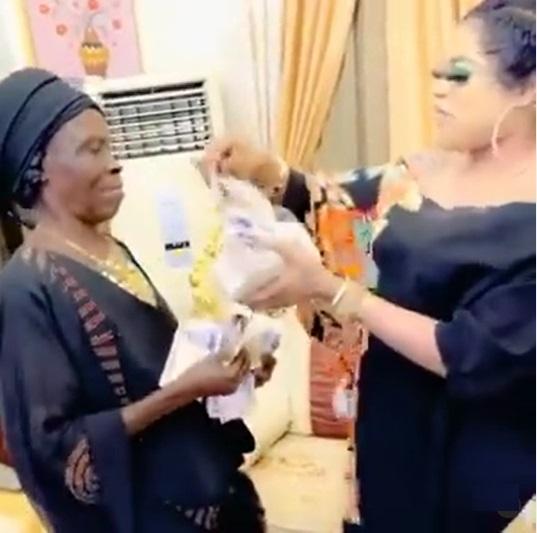 Bobrisky spoils grandma who declared love for him with stash of money (Video)