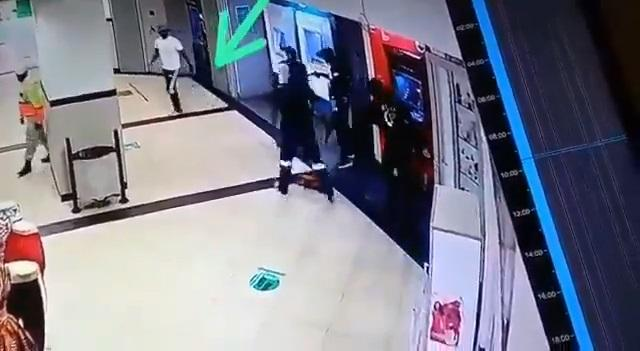 Moment security officer walked away unconcerned as robbers takeover store (Video)
