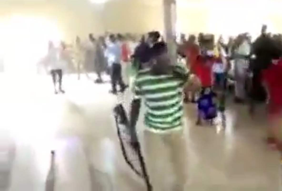 Watch church members praying with guns, cutlasses, other weapons to fight devil (Video)