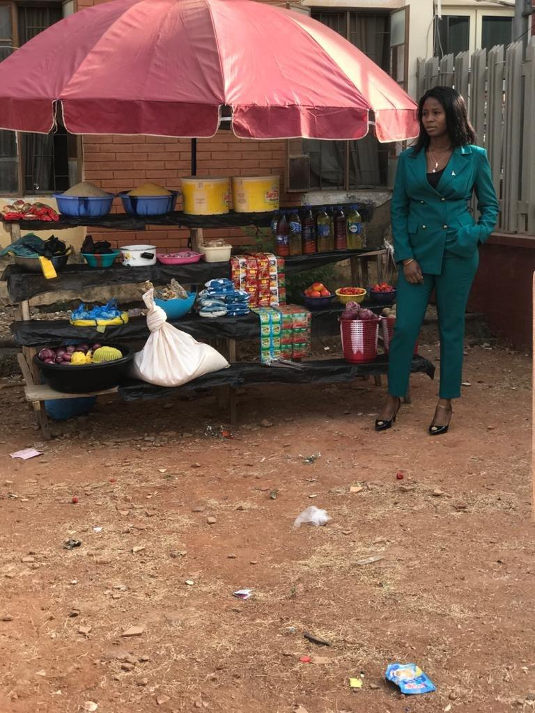 Lady leaves Nigerians in awe as she rocks corporate outfit to sell foodstuffs