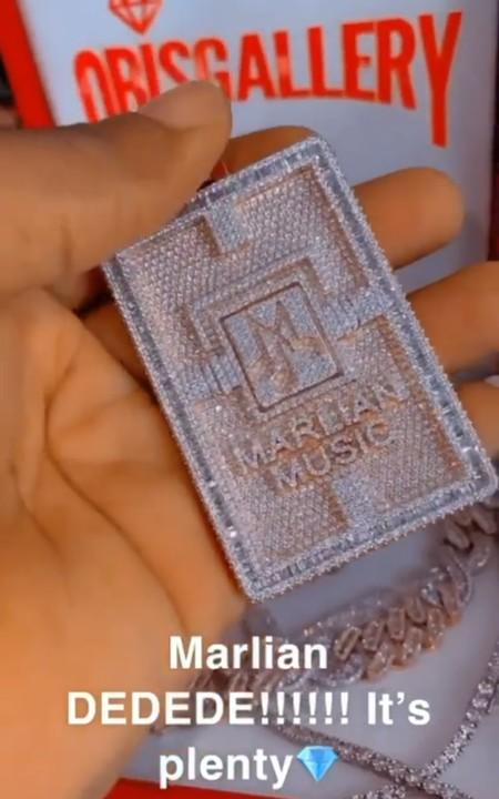 Singer, Naira Marley gifts himself customized diamond neck chain (Video)
