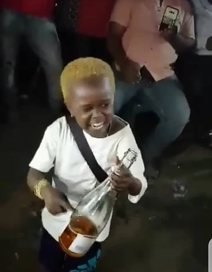 """Allow me to enjoy myself"" - Little boy screams while consuming bottle of alcoholic drink amid cheers (Video)"