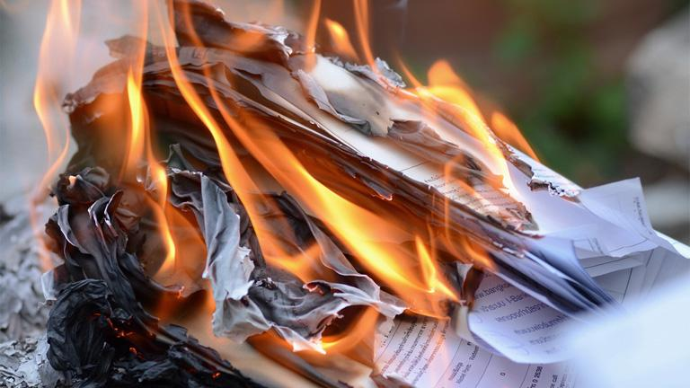 Husband burnt wife's  credentials