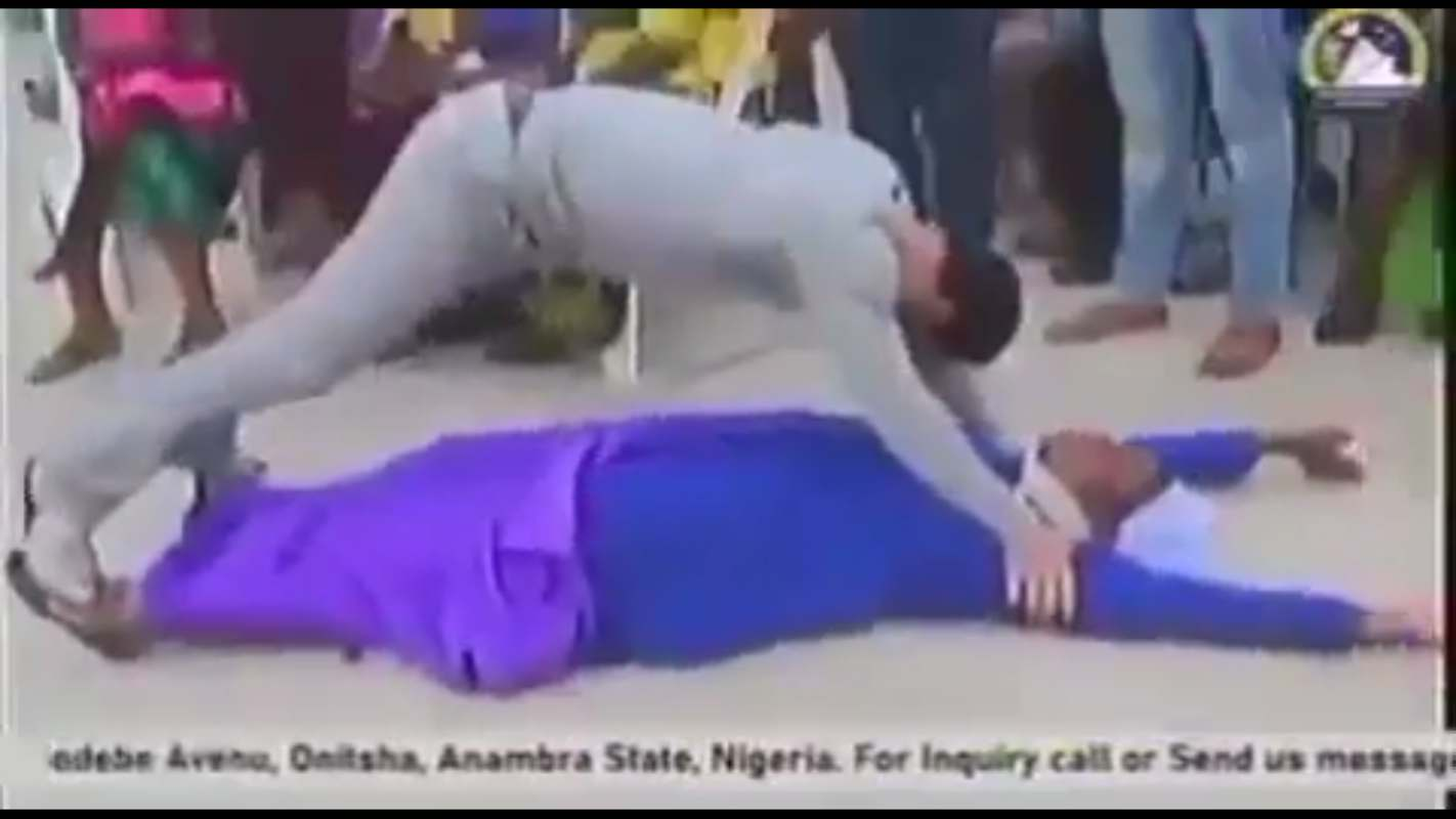 Pastor Odumeje performs deliverance in 'questionable position' on a woman, Nigerians react (Video)