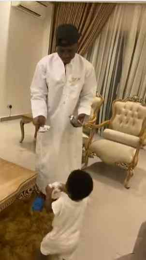 """""""If na girl na otherwise"""" - Zlatan Ibile expresses shock as son picks snacks over dollar bills (Video)"""